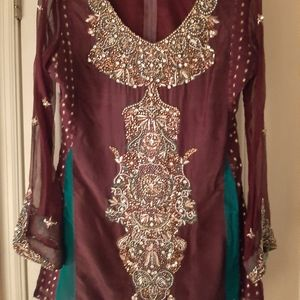 Middle Eastern Dress and brown pants with duppta.